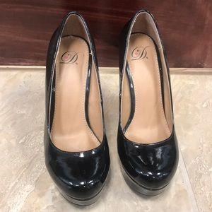 Shiny black wedged heel Size 7
